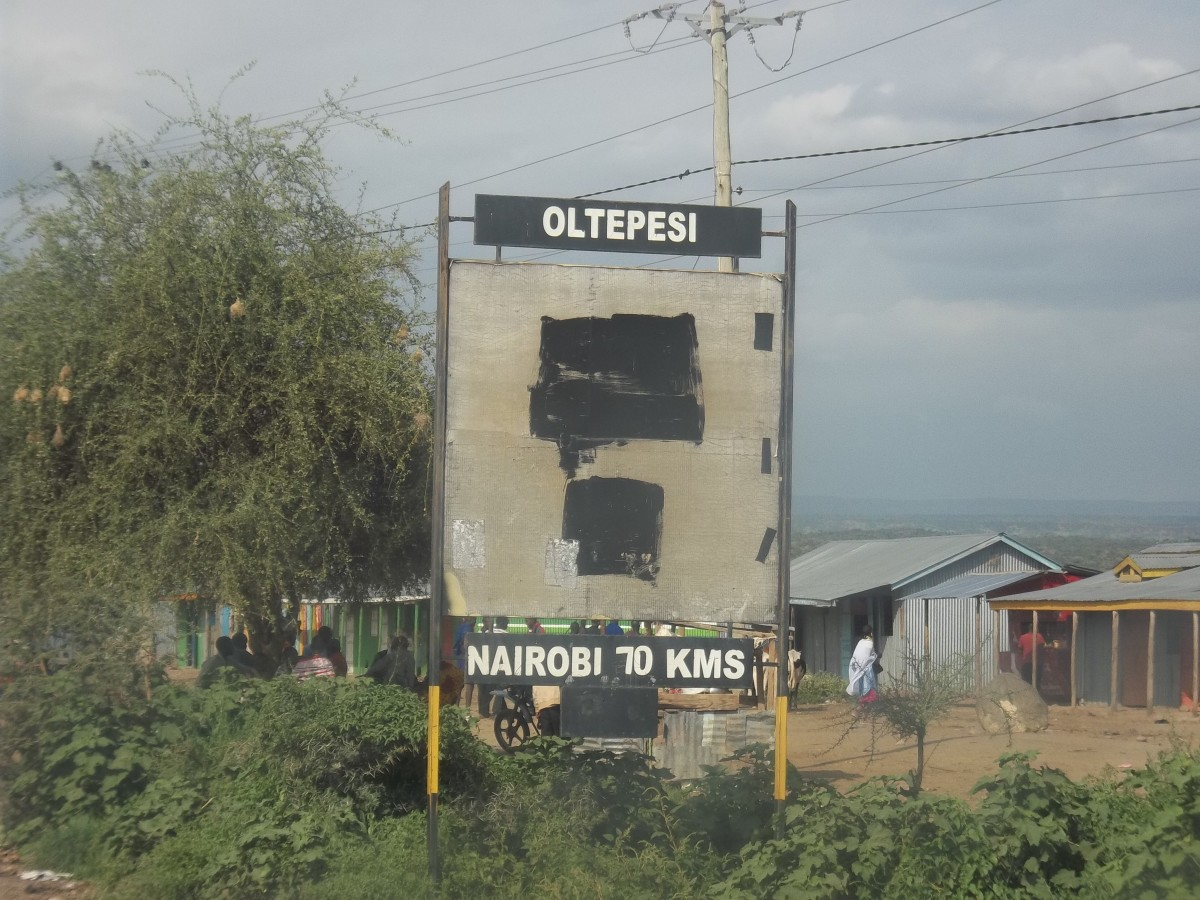 Road Sign indicating that Ole Tepesi is 70 kilometers from Nairobi on the Magadi road.