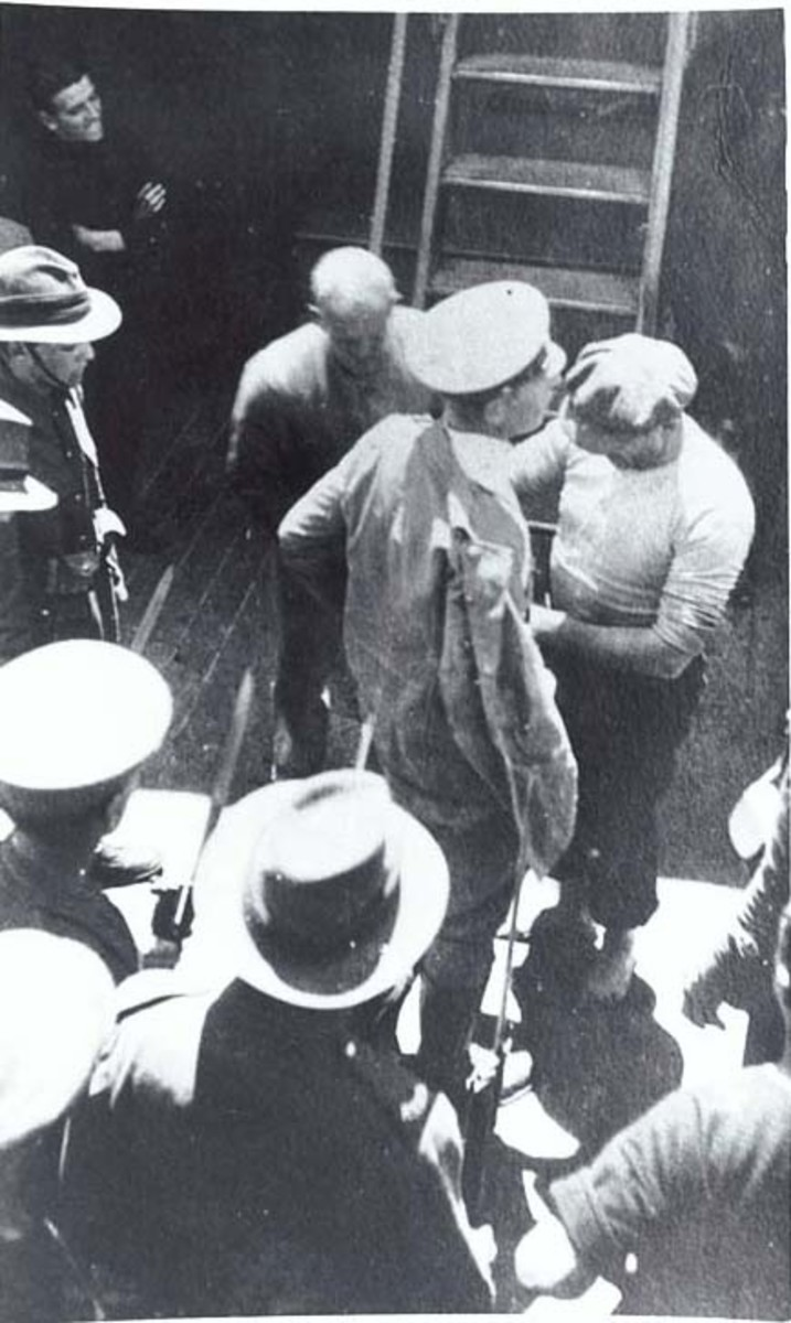 WW1: Luckner being searched on Iris after being recaptured after escaping from an internment camp in December 1917.