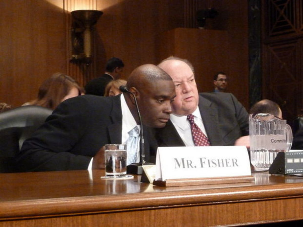 Glenville native Antwone Fisher, whose autobiography was made into a Hollywood film directed by Denzel Washington, chats with another witness at a Senate Finance