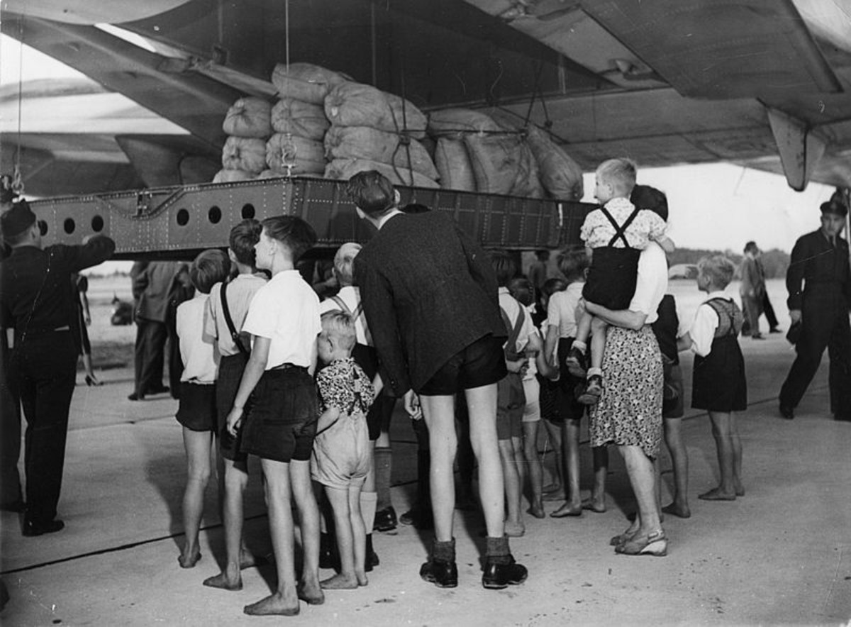 A U. S. Air Force C-74 Globemaster plane unloading more than 20 tons of flour from the United States (Aug 19, 1948) at RAF Gatow (British airfield in southwest Berlin)