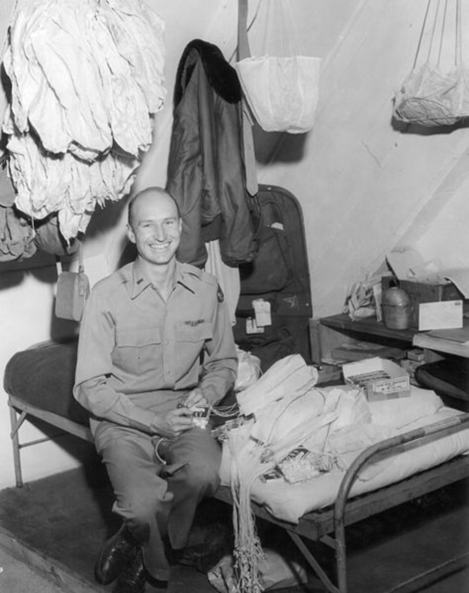 1st Lt. Gail Halvorsen (b. Oct 10, 1920) rigging parachutes for candy drops over Berlin during the Berlin Airlift (circa 1948).