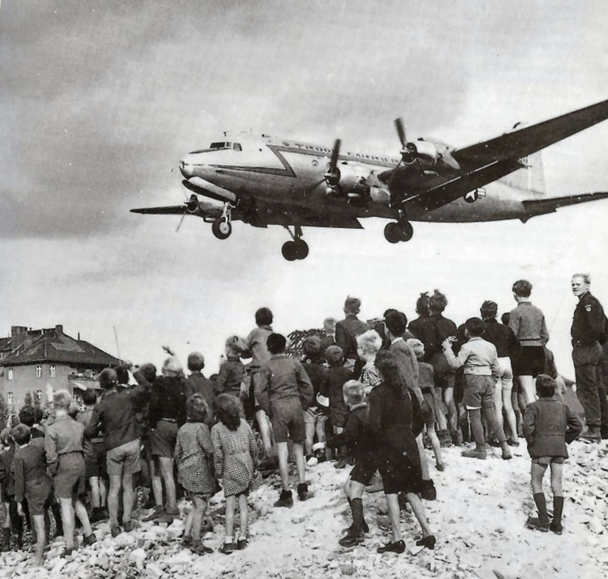 Berliners watch a C-54 land at Berlin's Tempelhof Airport, 1948