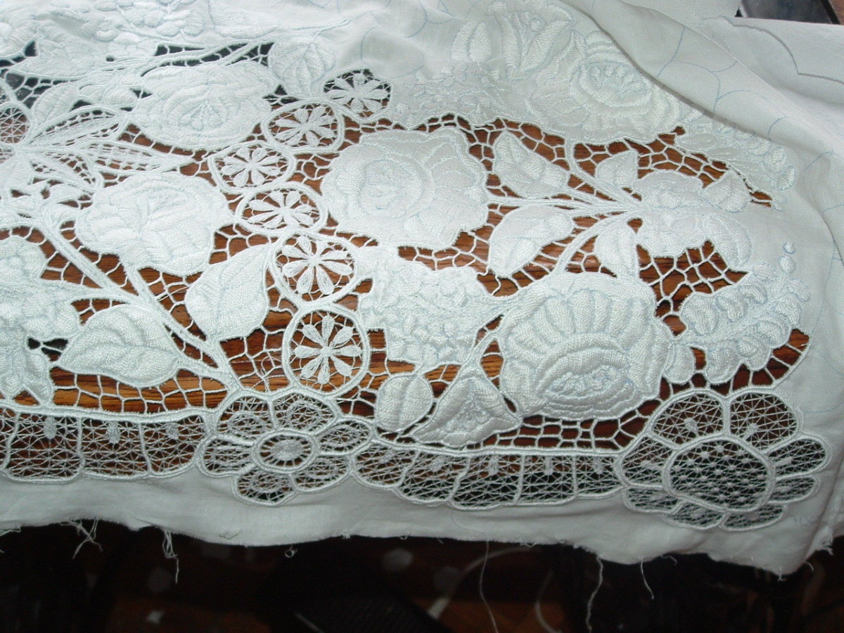 Before colorfast dyes became available, the embroidery work of this region was the white and cutwork pattern as seen on this piece of fine work.