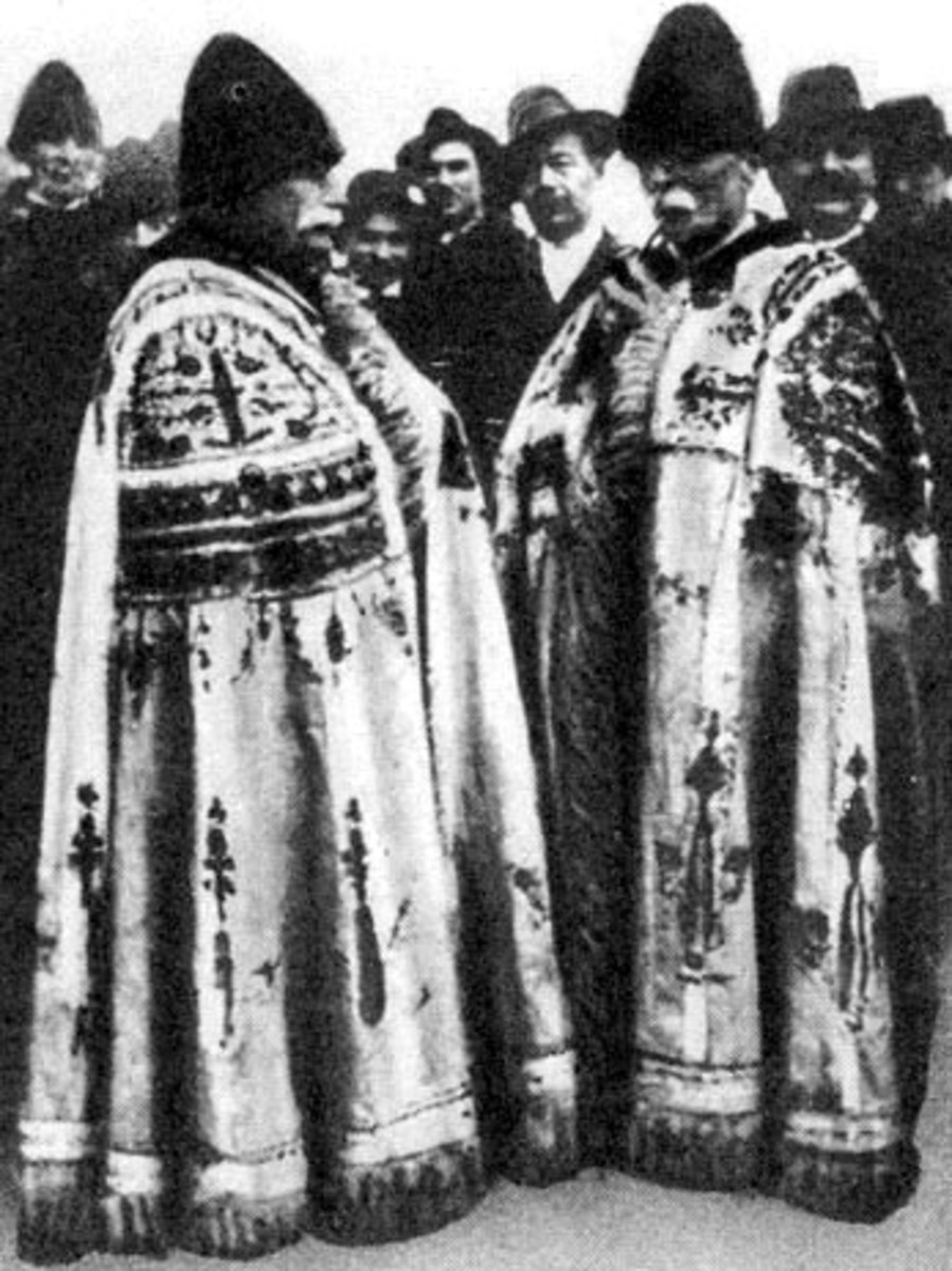 Vintage photo of men of Kalocsa wearing traditional capes heavily embroidered.