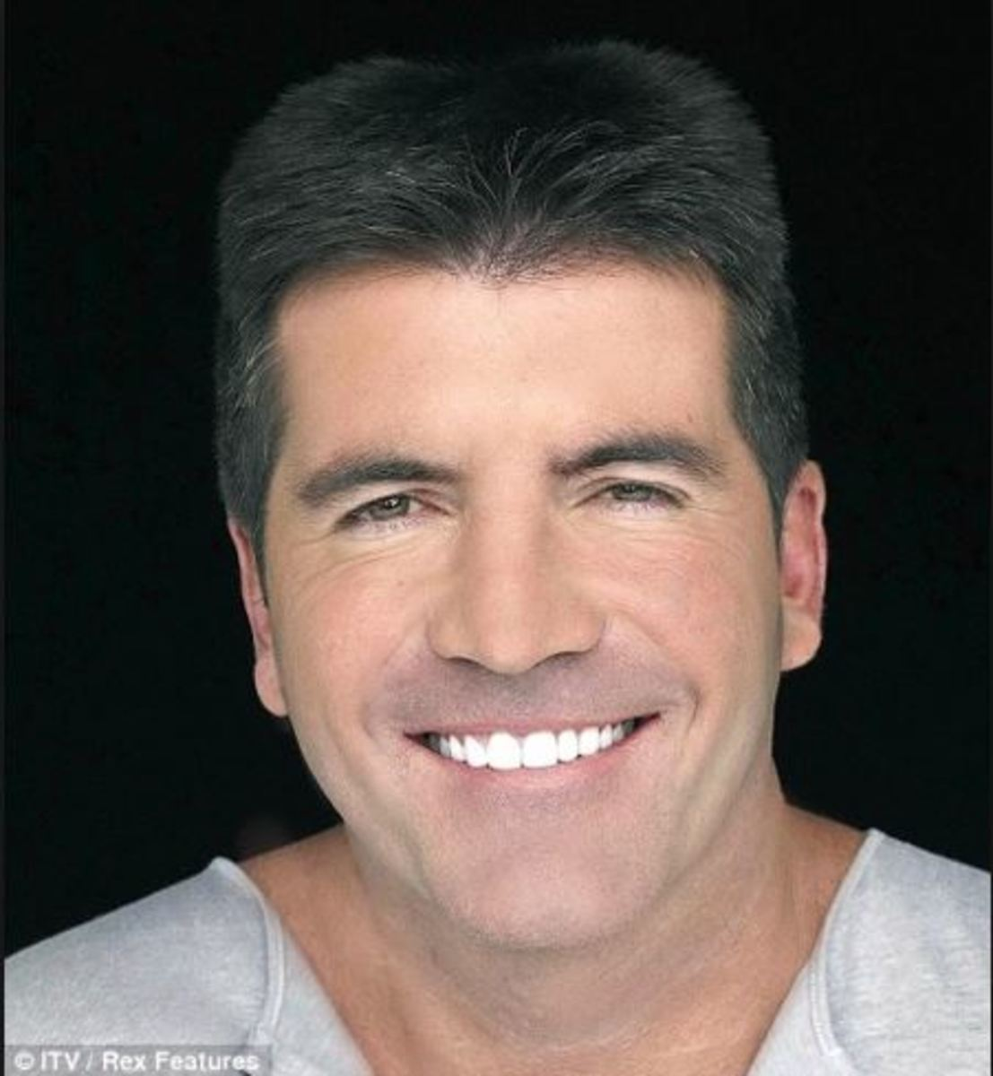 Simon Cowell, who smokes, is said to have spent thousands on getting his own smile just right