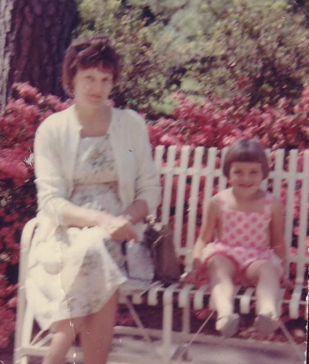 My mother and my middle sister, sitting on a bench on the grounds of the Bradley Library in my home town.  My mother always cut my middle sister's hair like Dorothy Hamill for some reason.