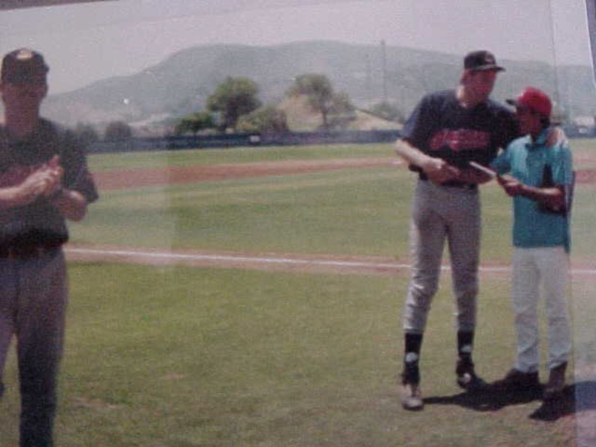 That's my manager, J.R. Caviness handing me the MVP Award in the '96 NABA All Star Game at Moorpark College (CA)