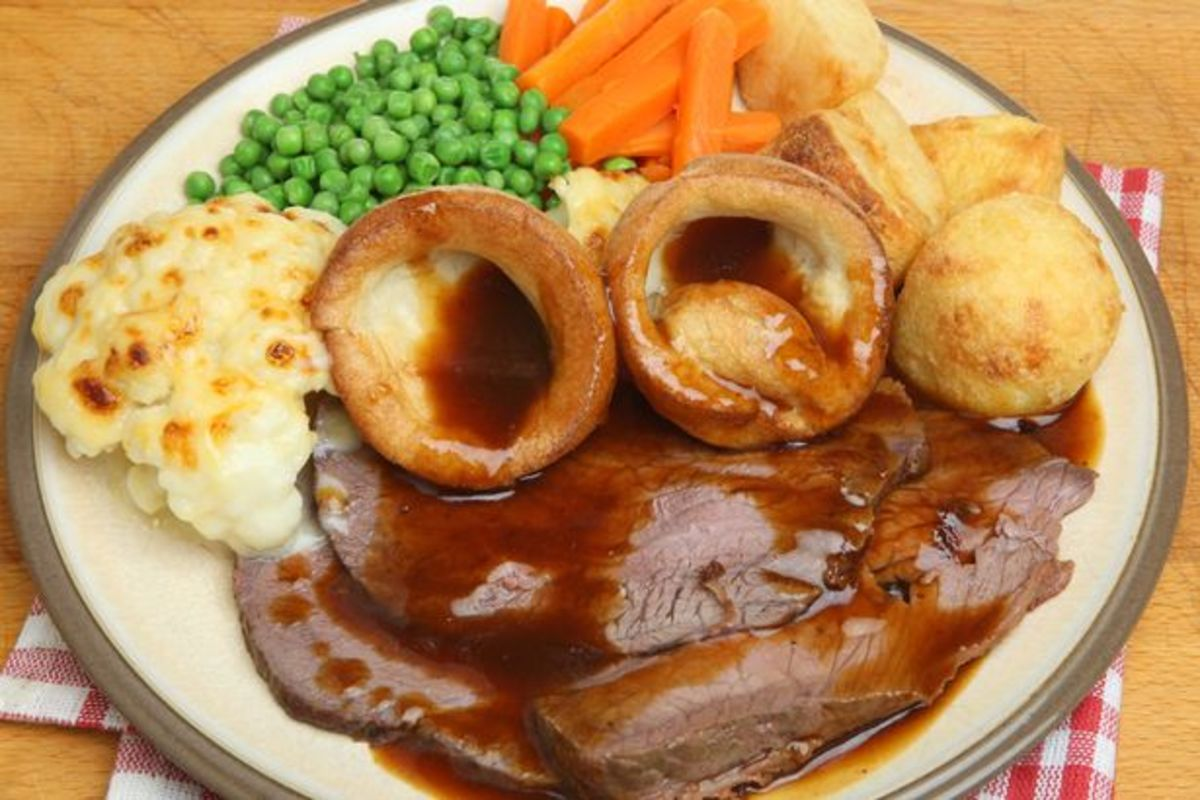 How about a Sunday roast with all the trimmings? Yorkshire puds, roast spuds, roast beef and gravy, peas, carrots and cauliflower...