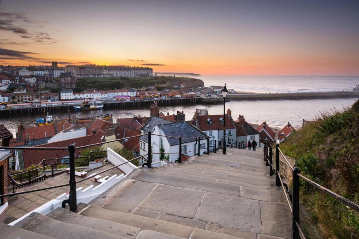 Here's looking north over Whitby Harbour of an evening - did Count Dracula come to celebrate Yorkshire Day? His timing was a bit off. Bram Stoker stayed at a hotel on West Cliff, across the harbour from here and immortalised Whitby in his writing