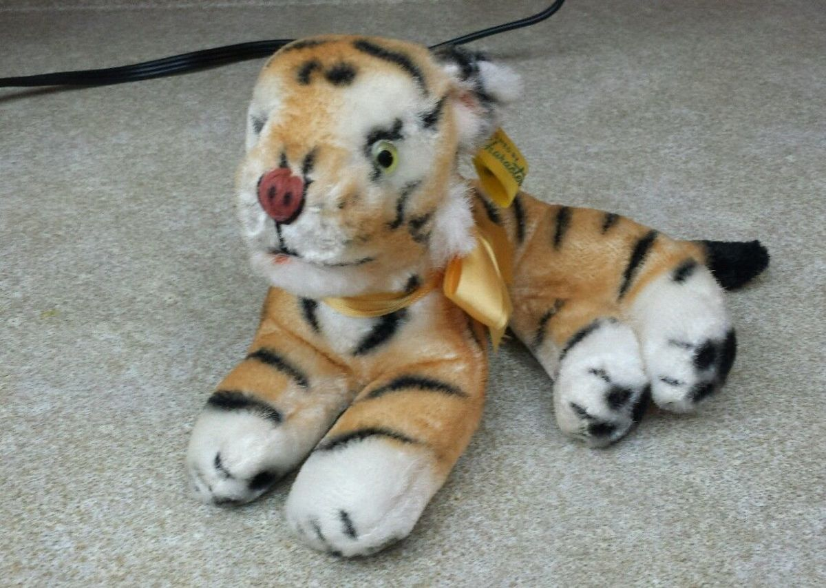 Here is a beautiful vintage Bengal tiger stuffed animal that was Designed by Character Novelty Co. back in the golden age of toys, the 1950s,