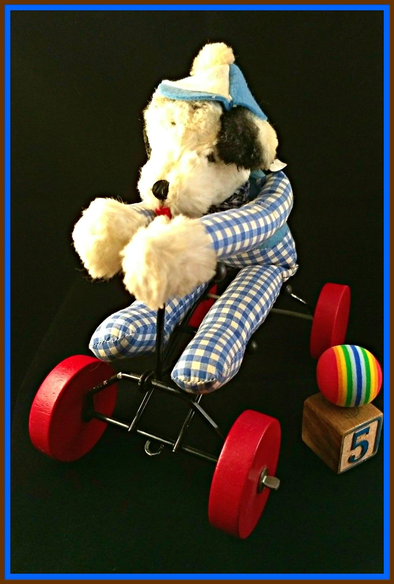 "The Character Novelty      Company (of Norwalk, CT)  was in production from the mid 1930's to the mid 1980's.  Here is a delightful toy, most likely from the1950's to 1960's, is on wheels and ""records"" (the dog's body moves forward and back) ..."