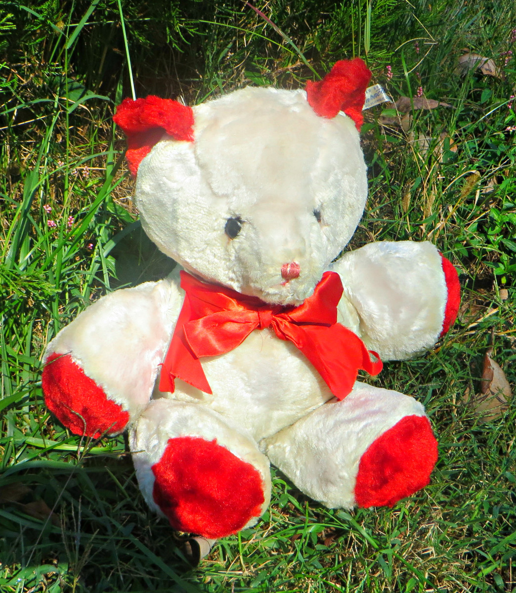 The Character Novelty Company Valentine Bear made in 1955, the very first Valentine Bear made by Character & was a market success, with a large number being bought by for women and teenage girls for Valentines.  His Ad display said he loves everyone.