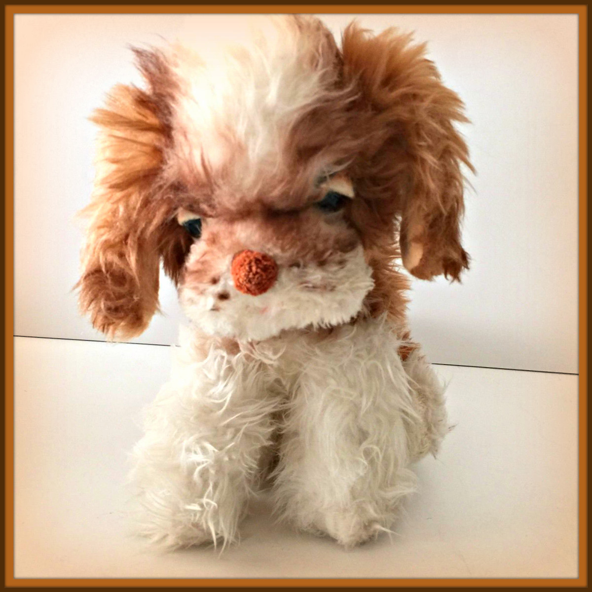 Beautiful vintage eleven inches tall plush dog by the Character Novelty Company, made in the United States back in the late 1950s.