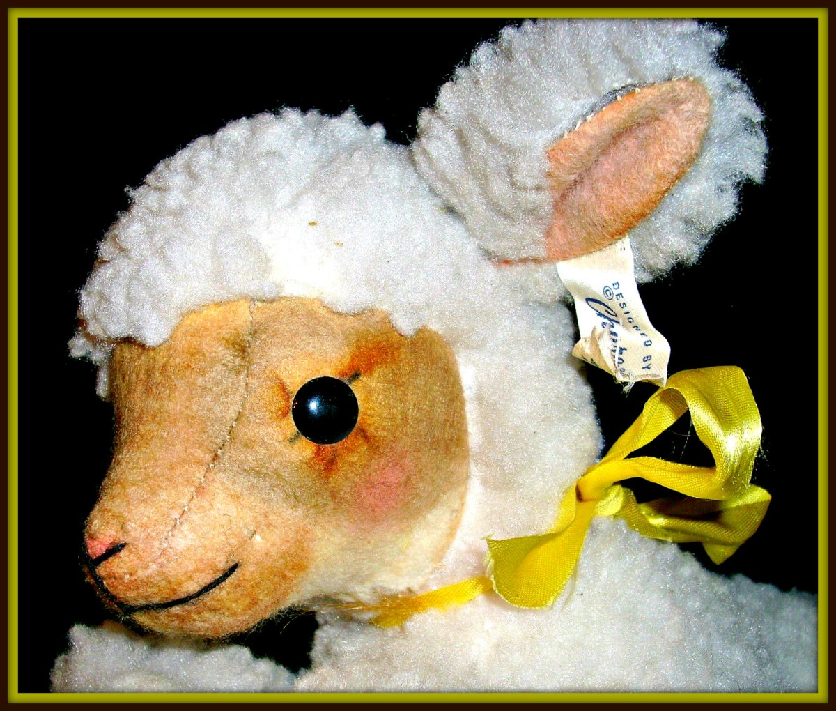 Made in 1961 this Character Novelty Company Easter or nursery Lamb is a wind up stuffed sheep and a plush toy. This little lamb was hand stitched and detailed in Connecticut with love.
