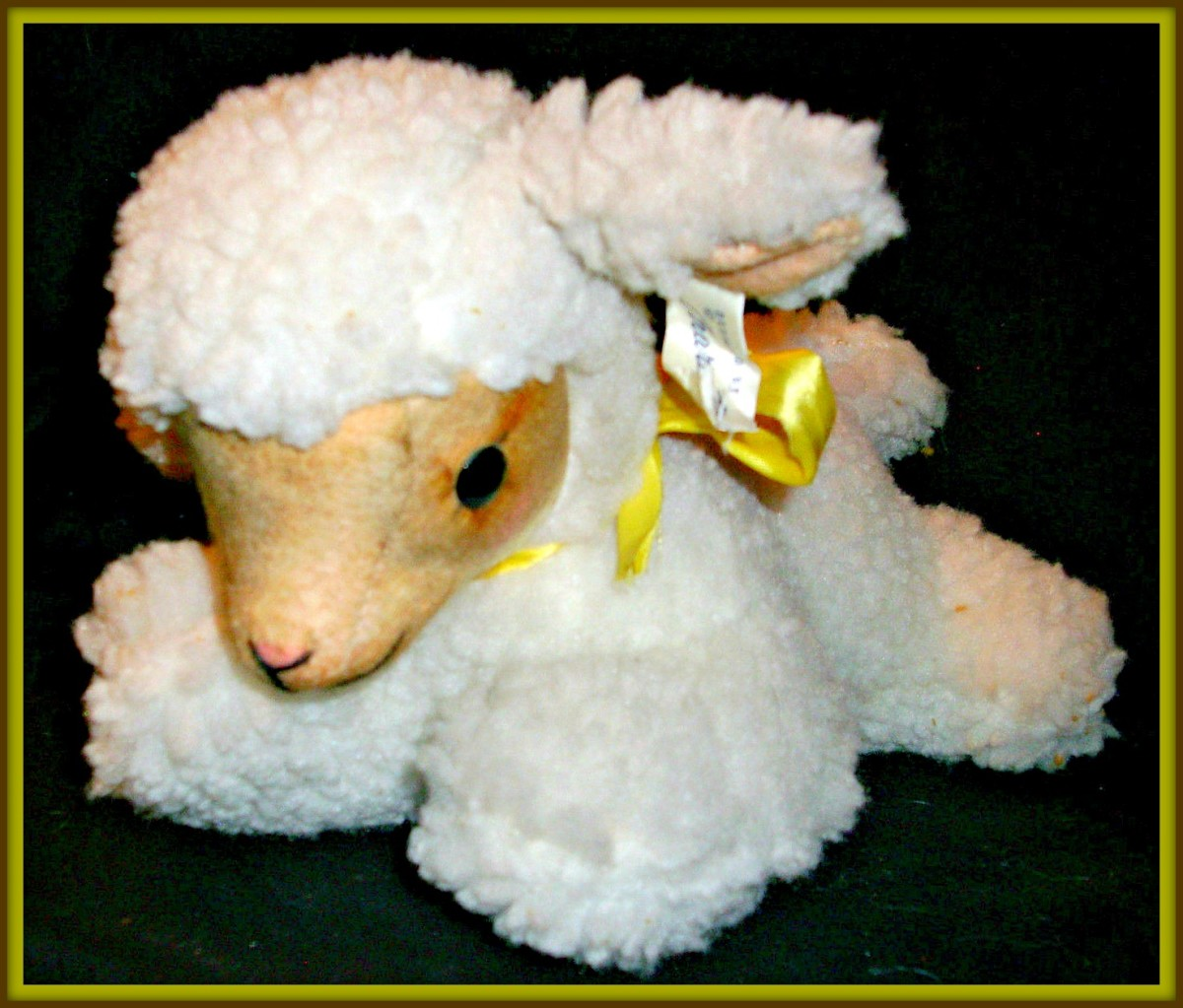 """Character Novelty Co. Easter or nursery Lamb that plays Music. She measures about twelve inches long, and  when you wind her up and she plays """"Rock A Bye Baby"""" :)"""