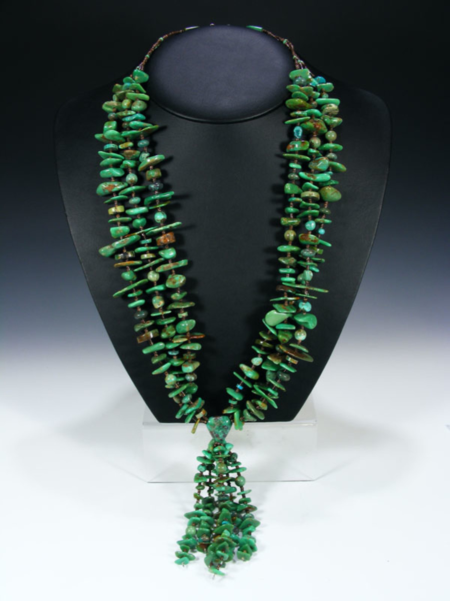 Turquoise necklace - large turquoise mixed with brown heishi and a jocla hangling from center