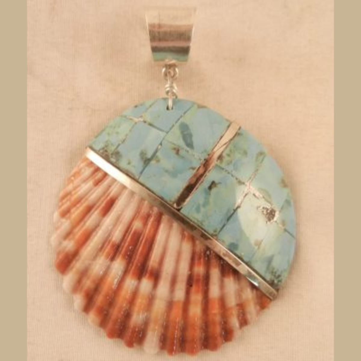 Shell, turquoise, and silver pendant