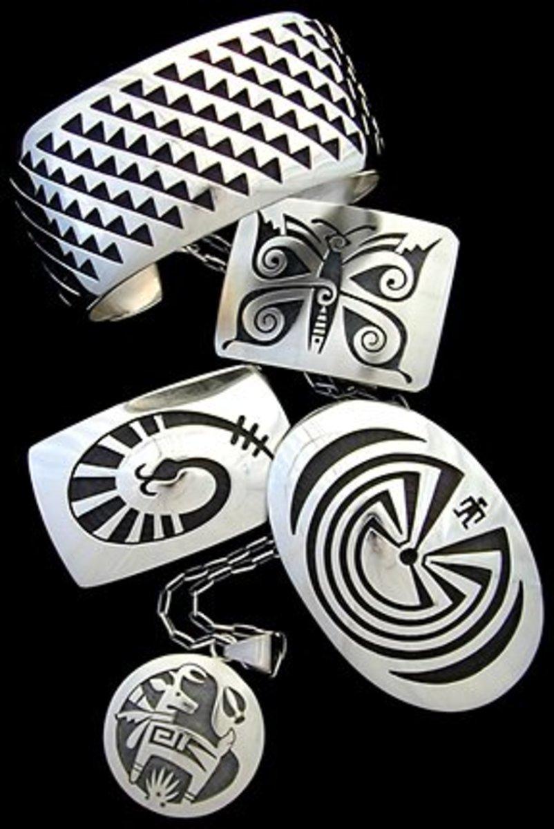 Hopi overlay designed silver jewelry.