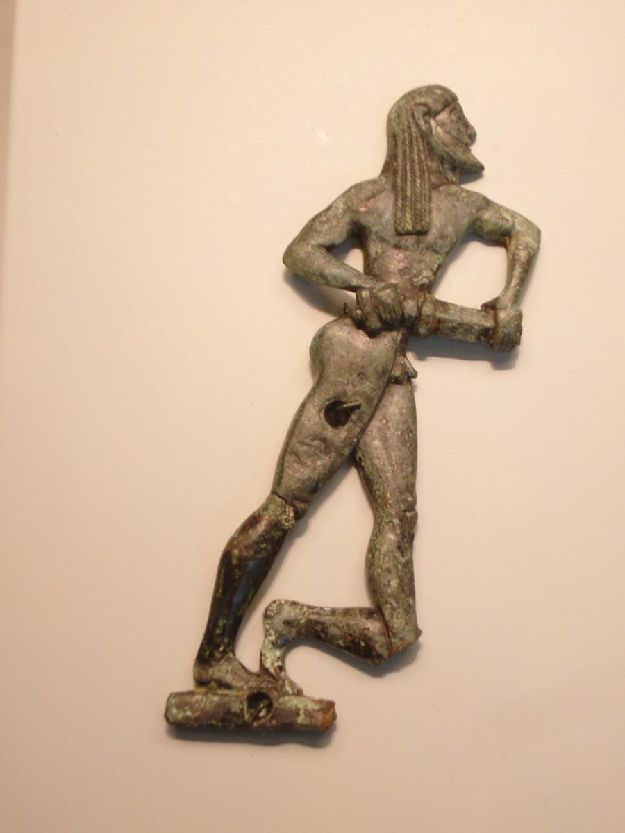 Bronze appliqué of Spartan manufacture, possibly depicting Orestes, 550-525 BC (Getty Villa)