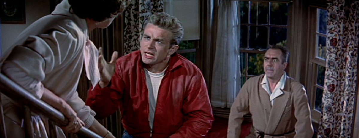 """Dad, stand up for me."" James Dean's character argues with his overbearing mother while his emasculated father looks on."