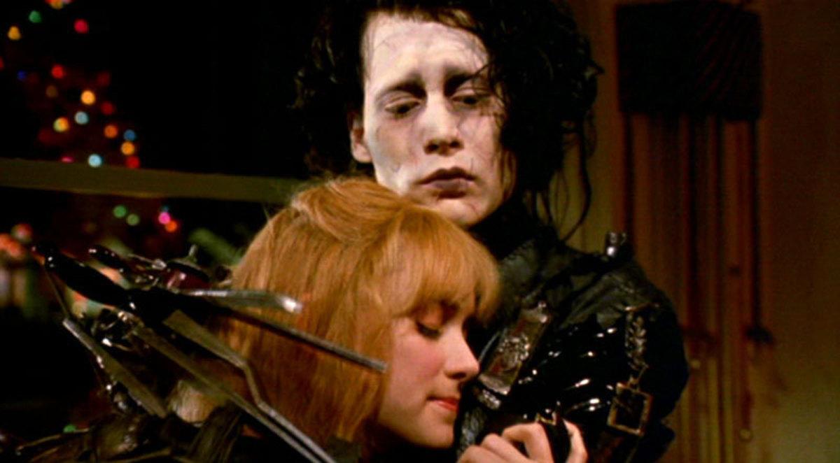 Johnny Depp as Edward Scissorhands and Winona Ryder as Kim Boggs