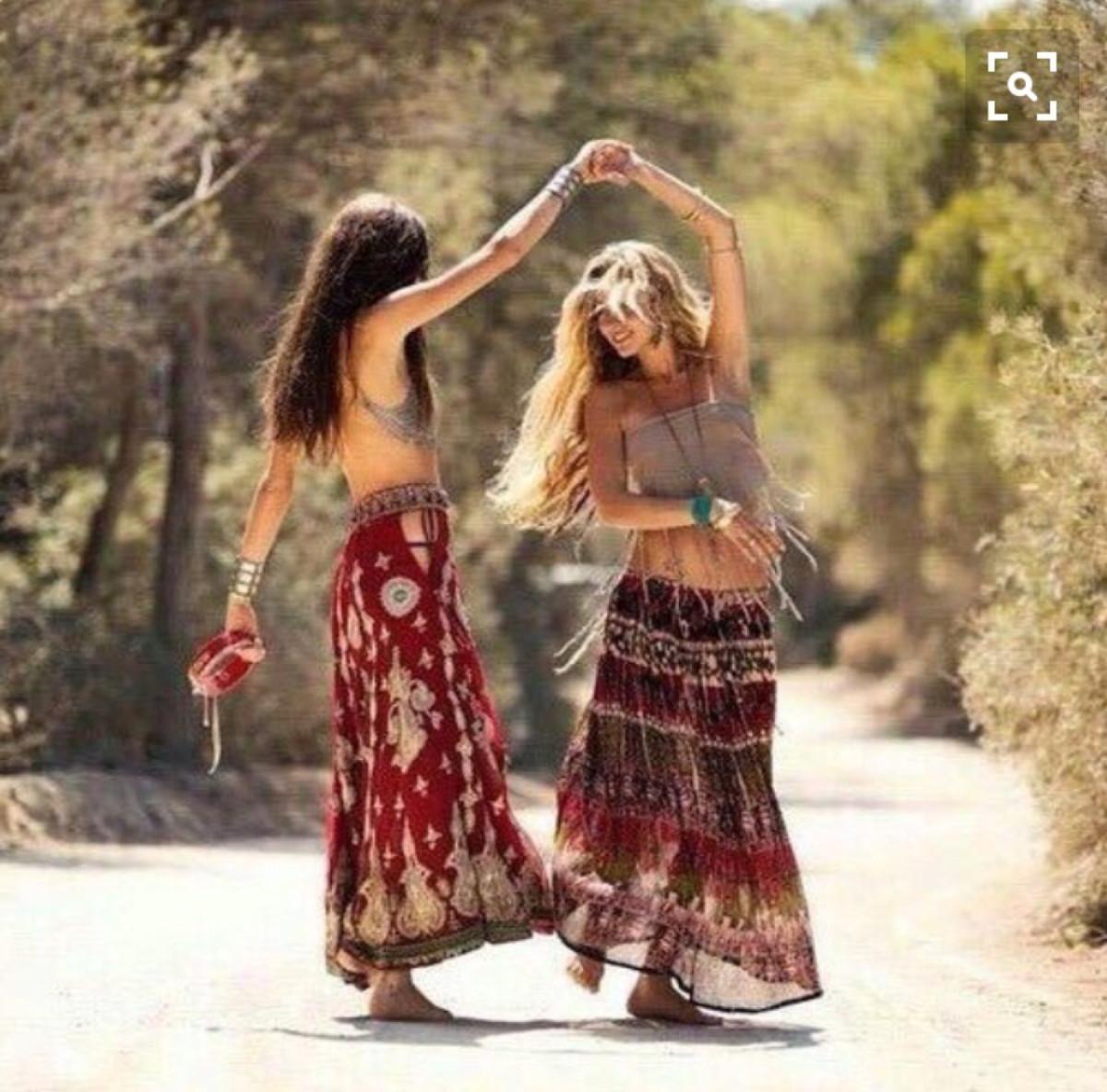 70's hippies dancing in the street