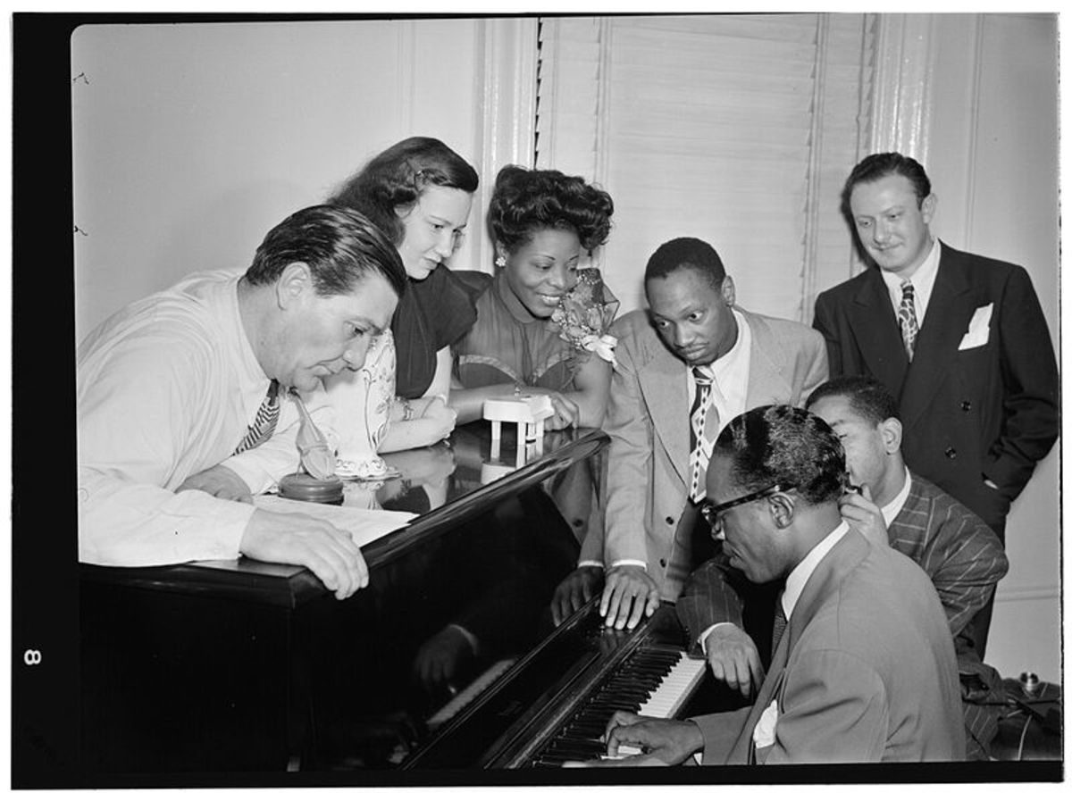 Jack Teagarden, Uknown Female, MLW, Hank Jones, Milt Orent,  Dizzy, and Tadd Dameron.