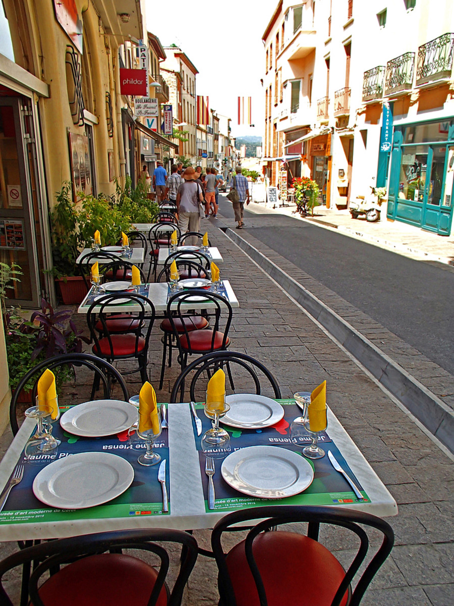 "Sidewalk tables for dining ""en plein air"" at a restaurant."
