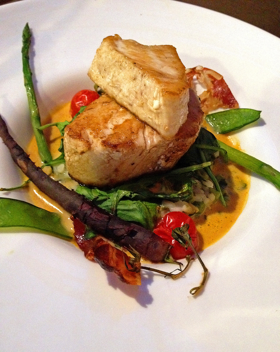 Pan seared tuna in saffron sauce, with Mediterranean rice and sauteed baby vegetables at Le Chapon Fin.