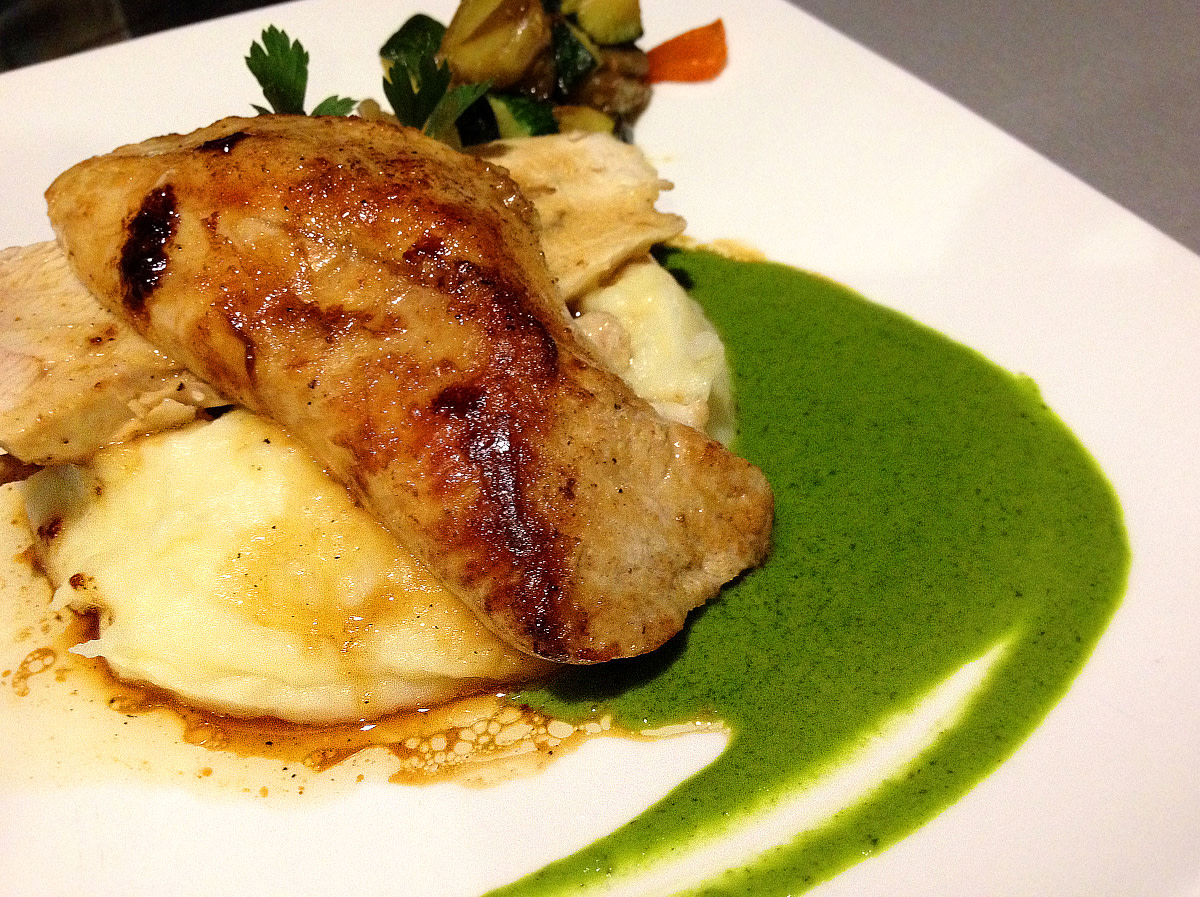 Roasted chicken breast with mashed potato and garlic parsley sauce at Le Trivalou.