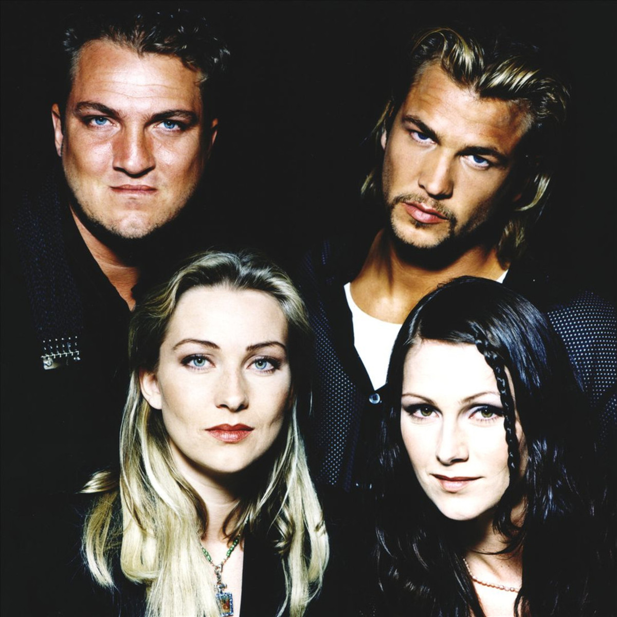 "From left to right: Jonas ""Joker"" Berggren, Ulf ""Buddha"" Ekberg, Linn, and Jenny."