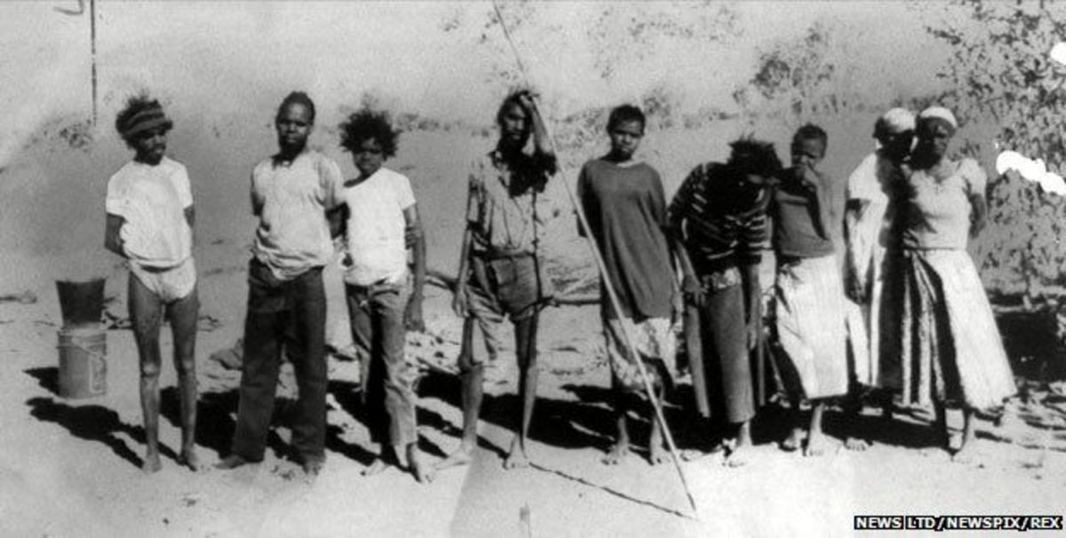 "This is a photograph of the ""pintupi nine"" in 1984.  The group consisted of two sisters and their seven teenage children - four brothers and three sisters, who shared one father.  They were completely isolated from the modern world until 1984."