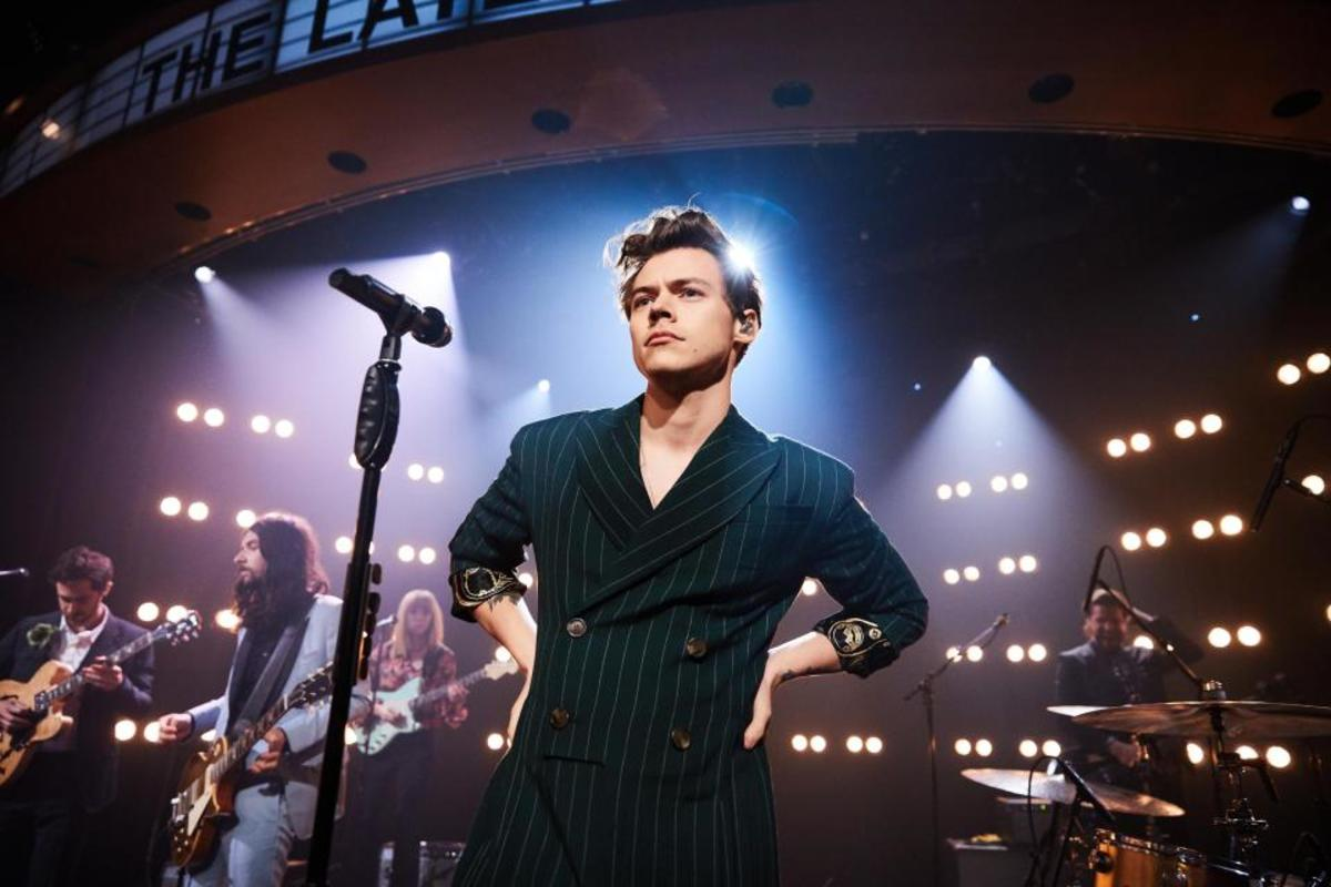 Harry Styles performing on stage
