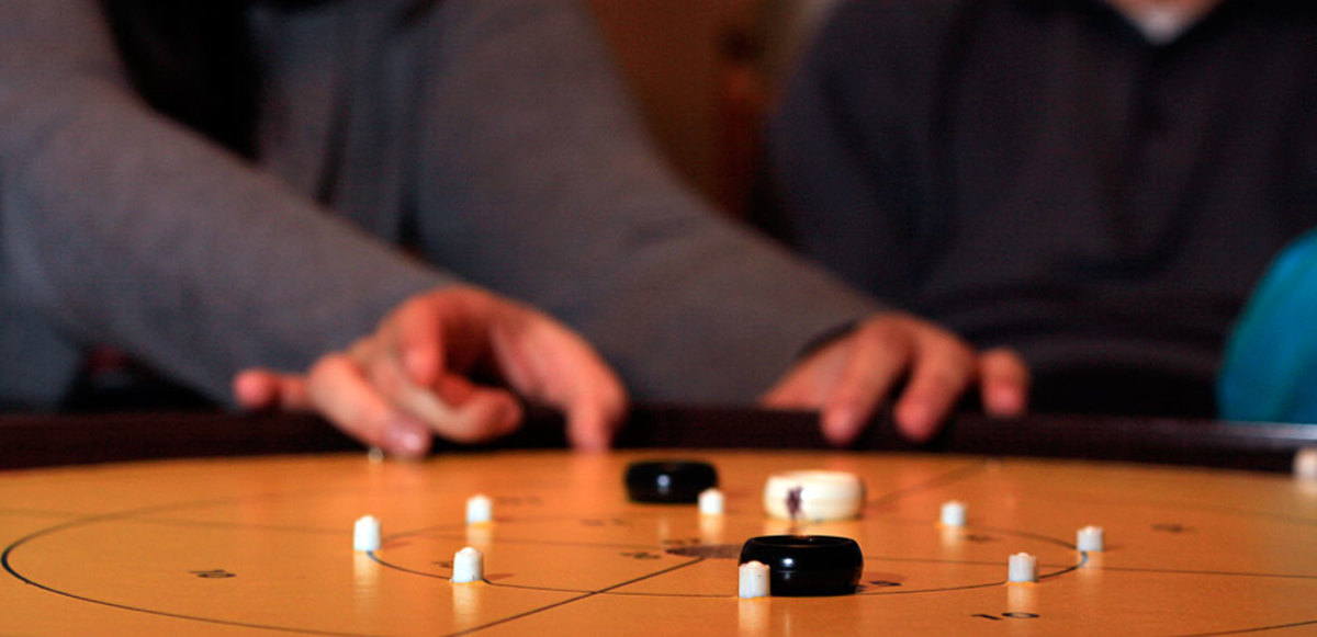 Why Crokinole is the Best Party Game Ever