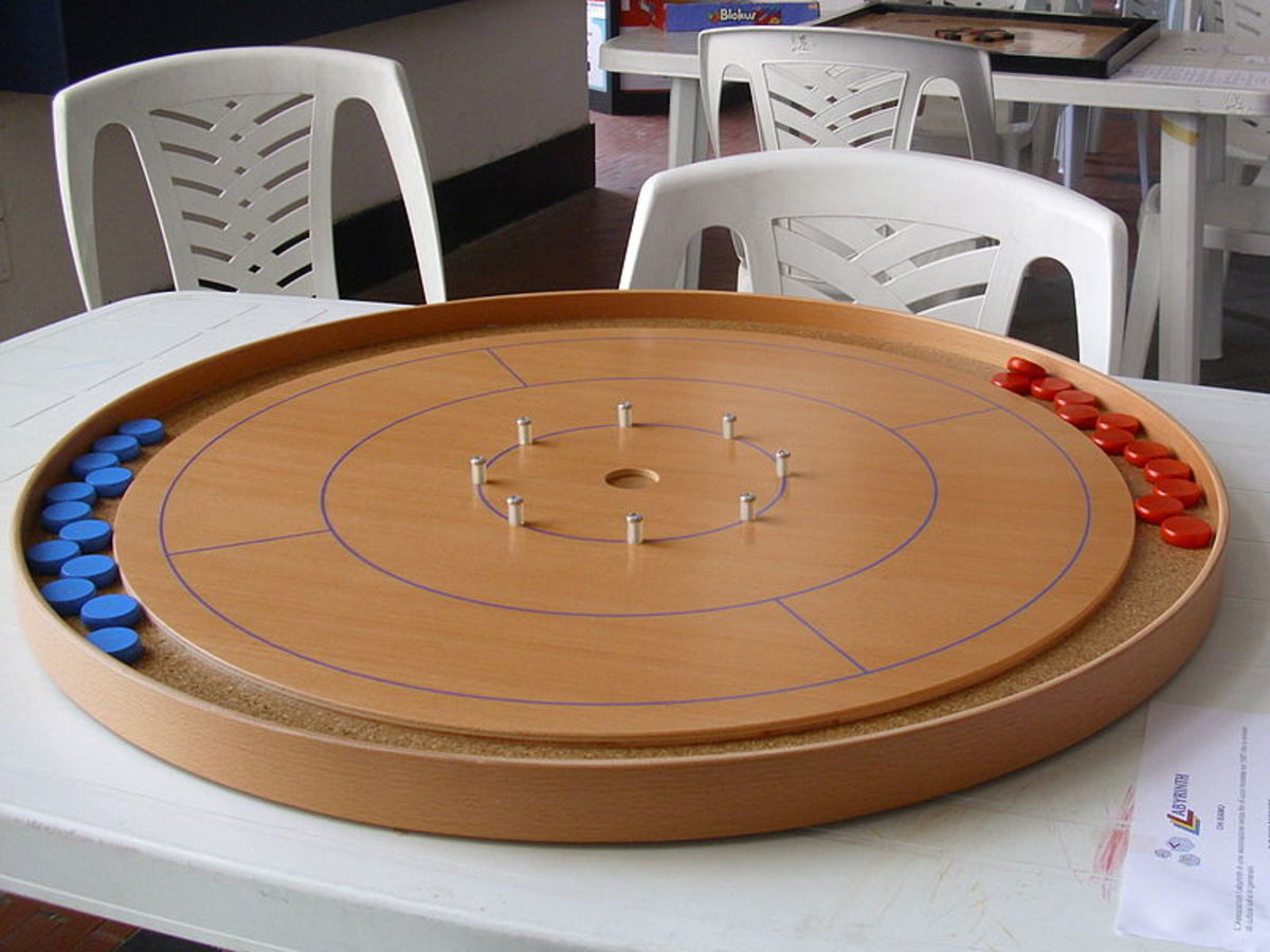 Crokinole board with Red and Blue Discs