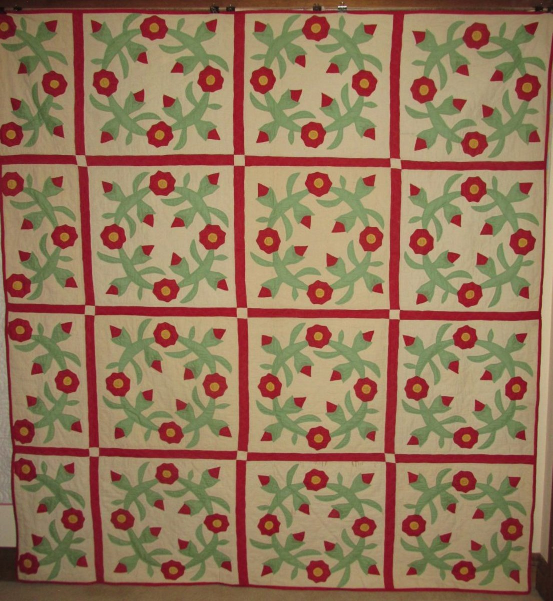 This antique quilt is a Rose Wreath hand appliqued quilt by Jeffie Beaver (Mrs. A. W. Smith 1894-1985).