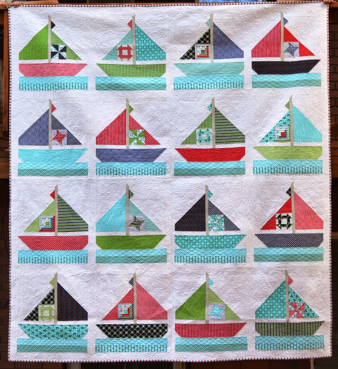 Adorable example of a sailboat pattern quilt.  How cute is this?