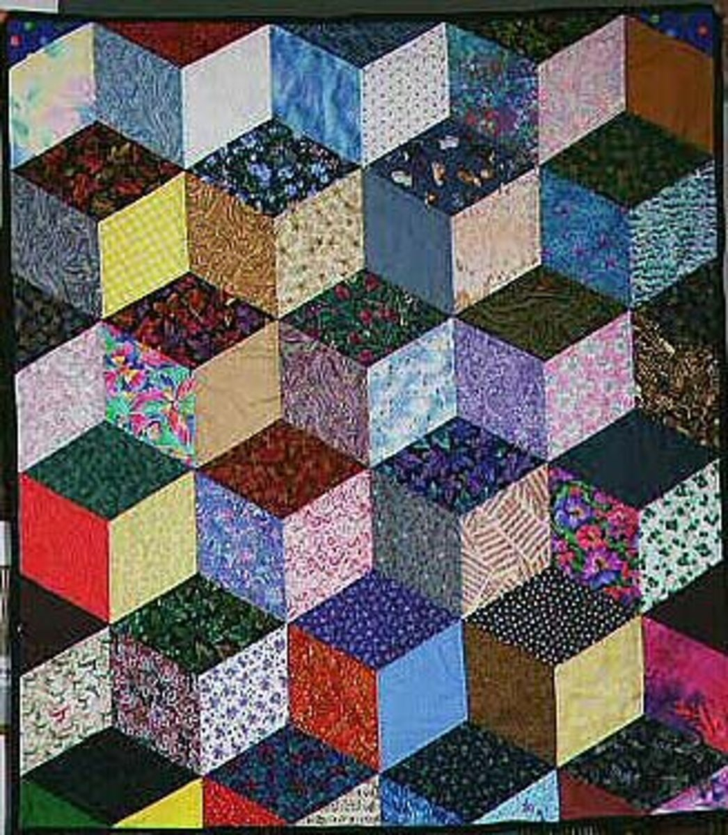 This interesting quilt is made with the tumbling blocks pattern.