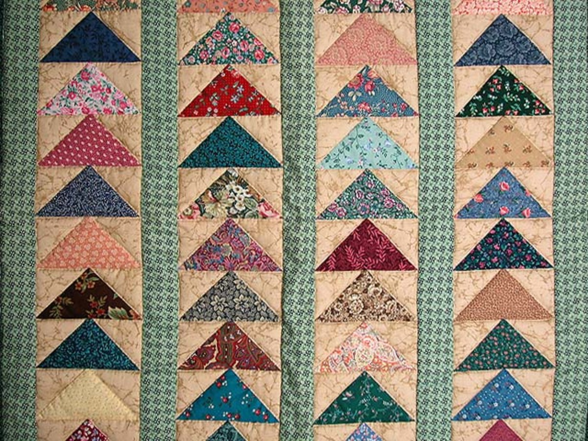 Impressive example of a flying geese quilt.