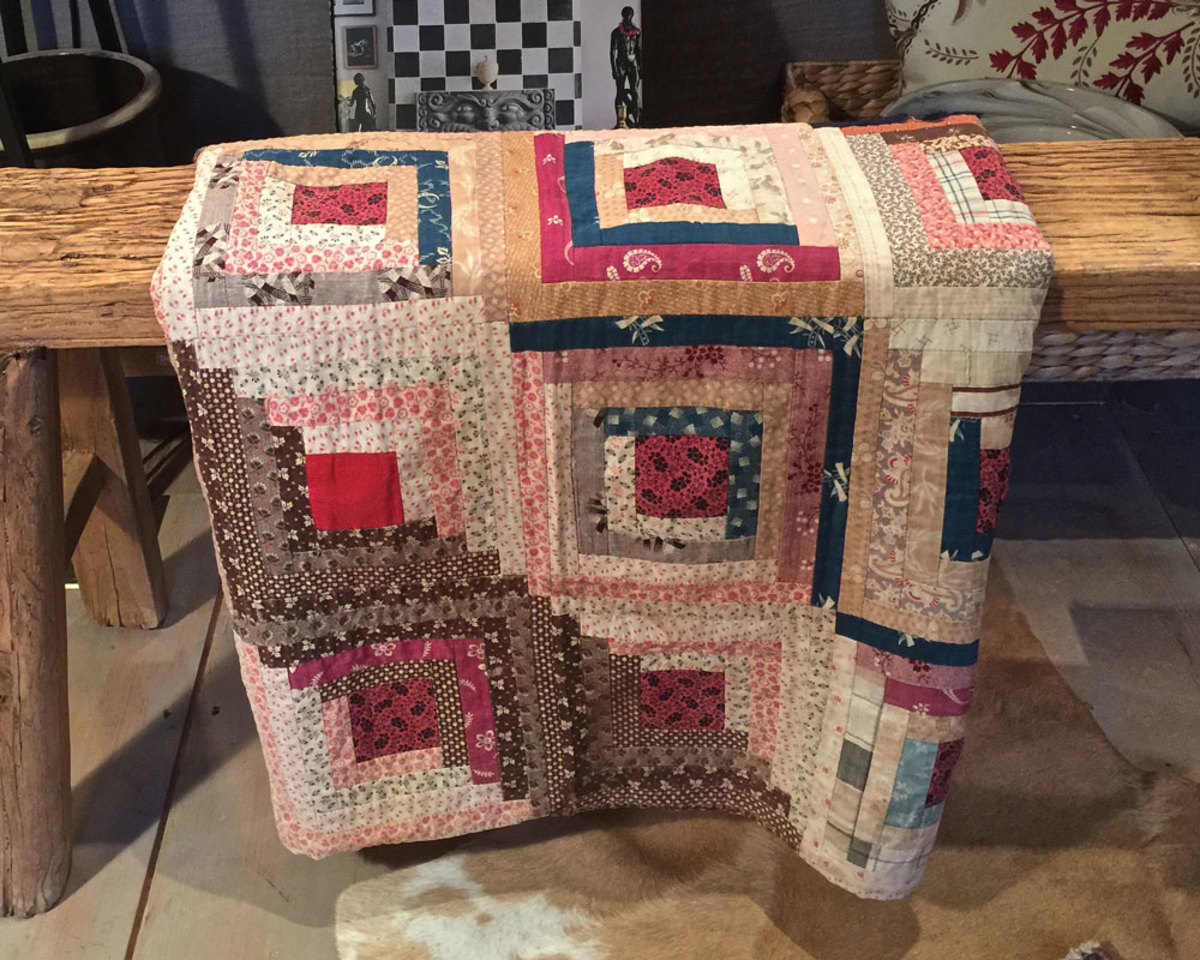 Beautifully sewn vintage log cabin quilt.