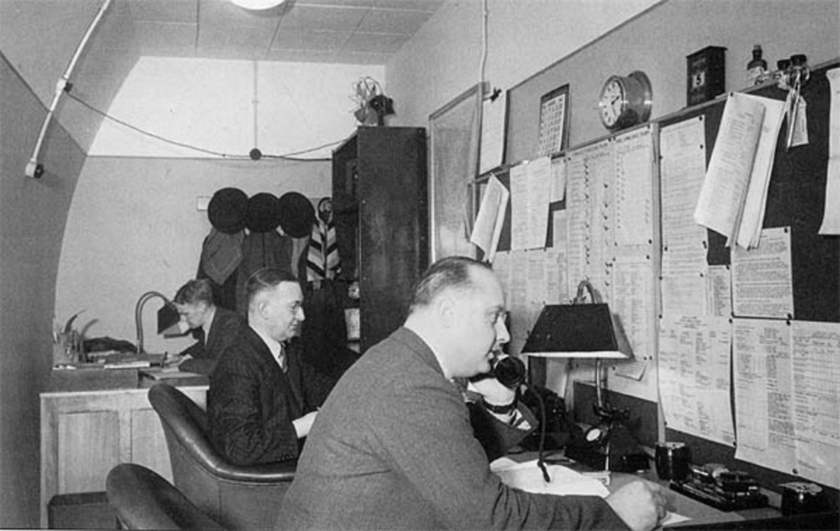 'Back-room boys', the phones are manned at the underground premises of the Railway Executive Committee (REC) to orchestrate operations around the whole of the railway network in wartime