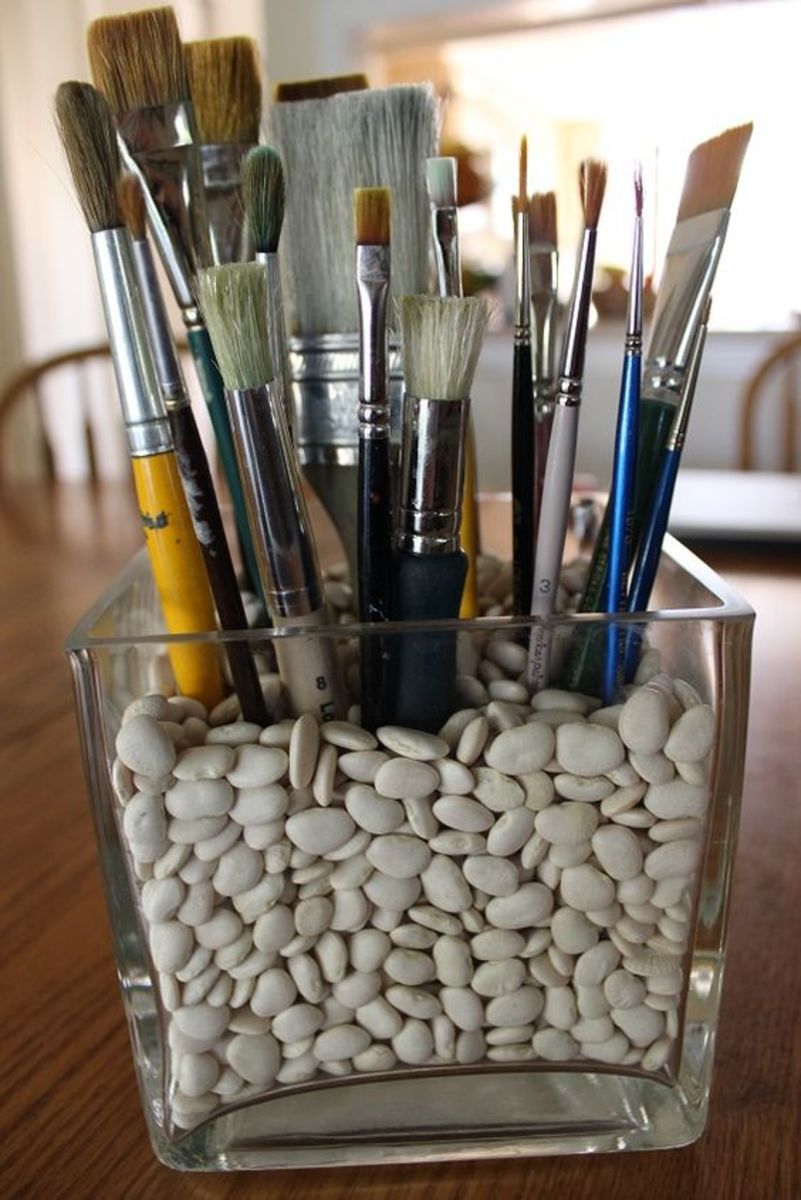 A simple dollar store vase and some beans, make a wonderful paint brush holder.