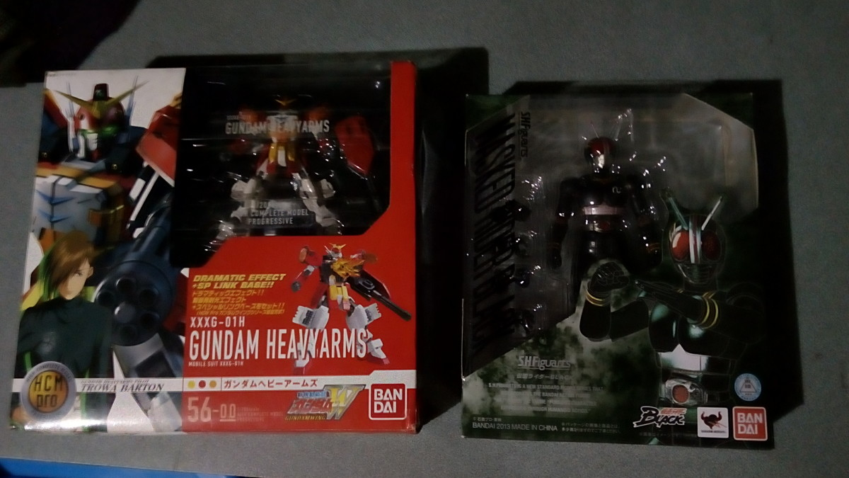 The HCM Pro Gundam Heavyarms (left) and my Figuarts Kamen Rider (right)