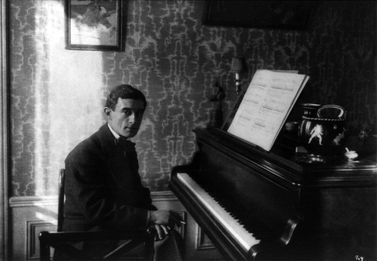 Maurice Ravel seated at the piano in 1912.