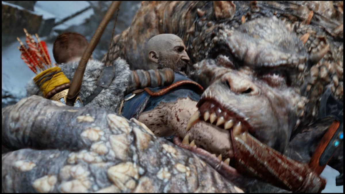 Kratos shoving his arm into the mouth of an oger so it bites him instead of his son.