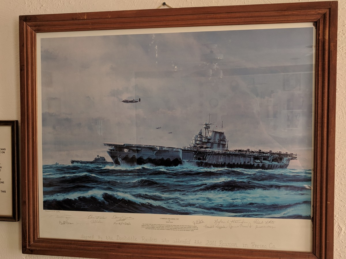 "Picture of Painting by Robert Taylor titled ""Compass Heading 270°"" depicting Aircraft Carrier Hornet with Lt Col Doolittle (first off) overflying ship while other prepare to launch.  Painting from 2001 Raiders Reunion signed by all in attendance"