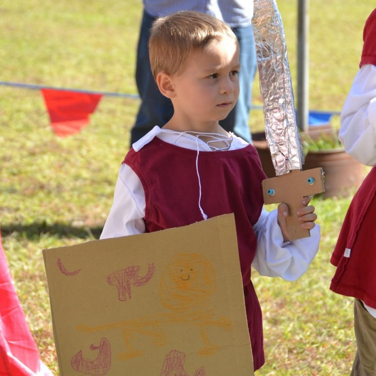 Making cardboard shields & swords was one of the activities we did this week at home during our History Morning Basket & Activities time from the above link on Knights & the Crusades.