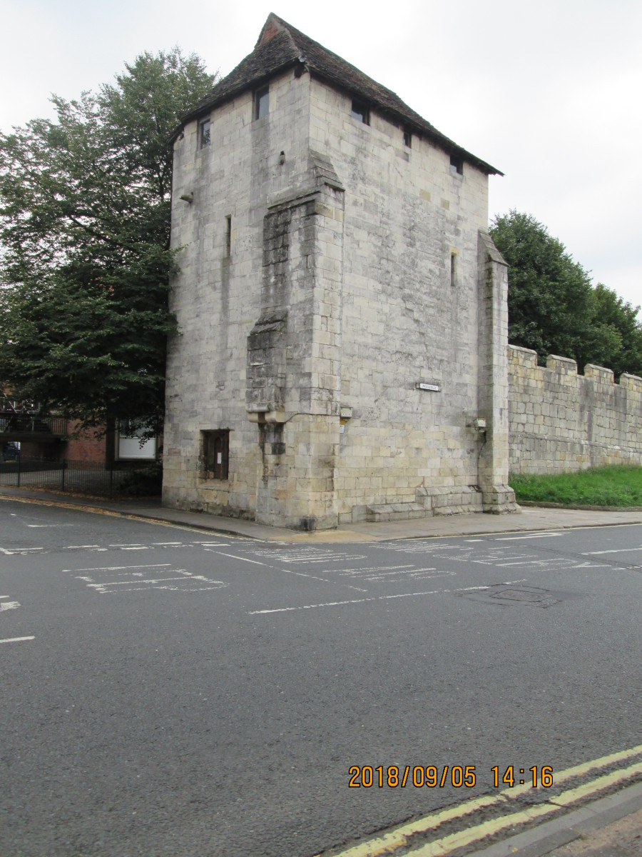 Tower Street, opposite the Travelodge hotel, you'll find this handsome structure that provides access to the wall walk. There are no hard and fast rules about which direction to take as long as you don't obstruct others. What you're looking at is...