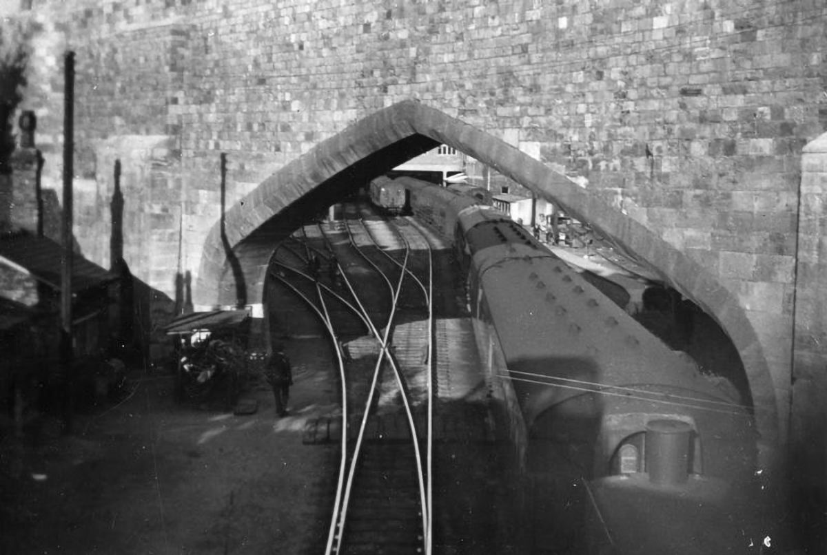 The archway through which trains from north and south met to enter York's older station. Carriages being moved through the arch by a diesel shunter, late 1950's or early 1960's after the steam station pilots were transferred to Newcastle-upon-Tyne