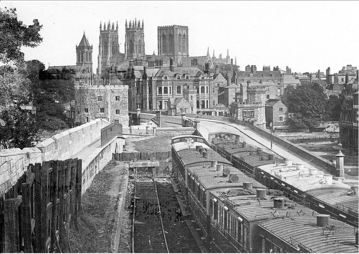 This is Lendal Bridge in 1868 and shows where the city wall stops at one of the bridge structures shown above. Beside the wall is where carriage sidings ran from the old pre-1877 railway station (behind you in this view)
